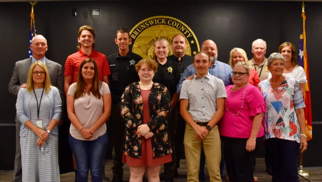 Pictured from left,  John W. Ingram V and Michelle Ingram; Damie and Zachery Bradley and son Chris Gondek; Kaitlyn Hodges and parents Chris and Angela Powell; Tyler Clemmons and parents Tim and Sue Clemmons; Monique Stenquist, fountain chair; Chris Kain, Beth Boling and Emily Flax, board members.