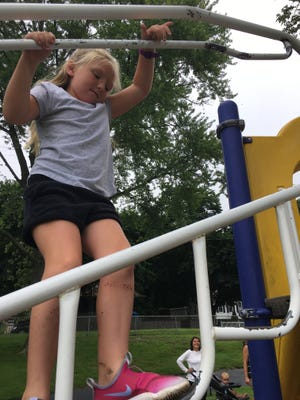 Sophie Craig, 7, navigates the Lions Park playscape in Plainfield. Proceeds from Thursday's Plainfield Bike Night event will go toward play equipment upgrades in three town parks.