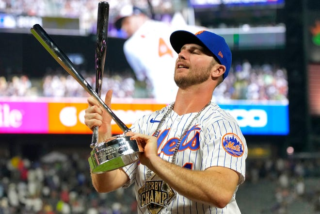 National League's Pete Alonso, of the New York Mets, holds the champions trophy after winning the MLB All Star baseball Home Run Derby.