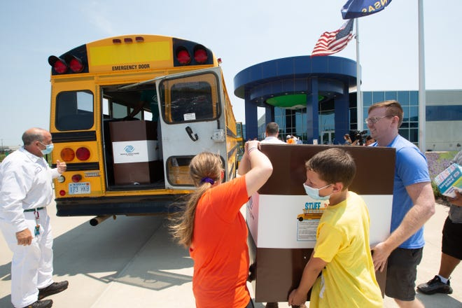 Staff and youths with the Boys & Girls Clubs of Topeka help load boxes of goodies donated Tuesday by Mars Wrigley outside of the factory at 100 Mars Blvd. The Stuff the Bus event has helped to benefit the club since 2016 and will be pushing to raise close to $90,000 this year.