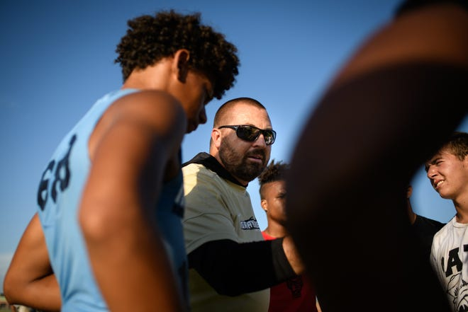 Gray's CreekÕs first-year head coach Jon Sherman talks to his players during practice on Monday, July 12, 2021.