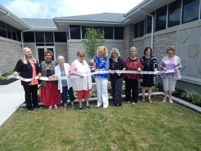 The ribbon was cut July 10 by Director Trista Rue, officially opening the new addition to Melton Public Library. Refreshments were served and tours were available of the new section. Pictured, left to right, are Lorrie Brosmer, Anna Grissom, Sharon Camarata, Suzanne Emmons, Rue, Robin Courter, Donna Verkamp, Trish Allen and Barbara Bowling.