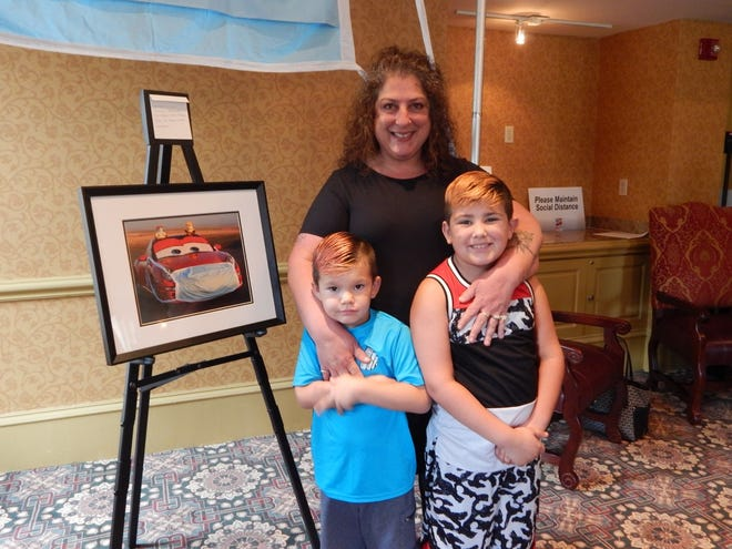 Xoch Owen and grandsons Jackson, left, and Chanc enjoyed the paintings at the Porsche Parade 2021 Art Show at the French Lick Resort on July 12.