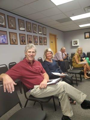New school board members Jon Iverson and Kari Lohrer attend Monday's school board meeting.