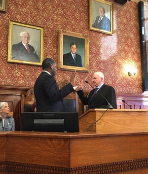 Cambridge Councilor Tim Toomey is sworn into office January 2020 in Sullivan Chamber.