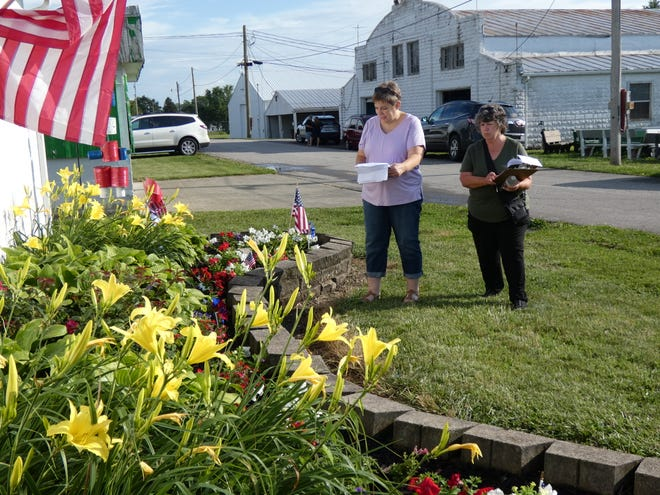 """Jill Hill, left, and Connie Kennedy judge an entry in the """"Company's Coming"""" landscaping competition at the Crawford County Fairgrounds on Monday evening."""
