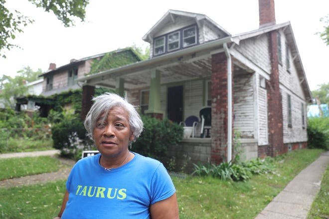 Rochella Stewart a lifelong resident of Detroit, in front of her home that is in need of major repairs Monday, July 12, 2021. Flooding has damaged the basement and the rest of the house is in need of repairs.