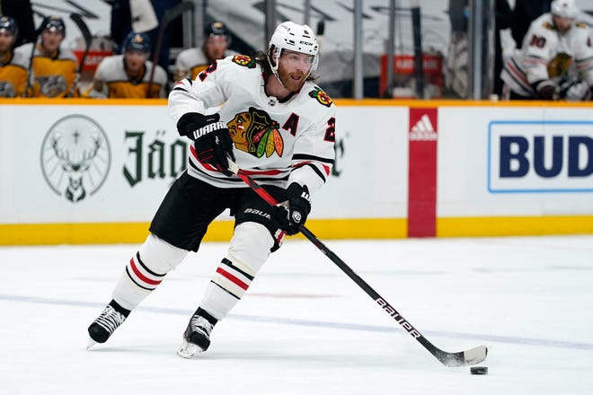 FILE - In this April 19, 2021, file photo, Chicago Blackhawks defenseman Duncan Keith (2) plays against the Nashville Predators in the first period of an NHL hockey game in Nashville, Tenn.