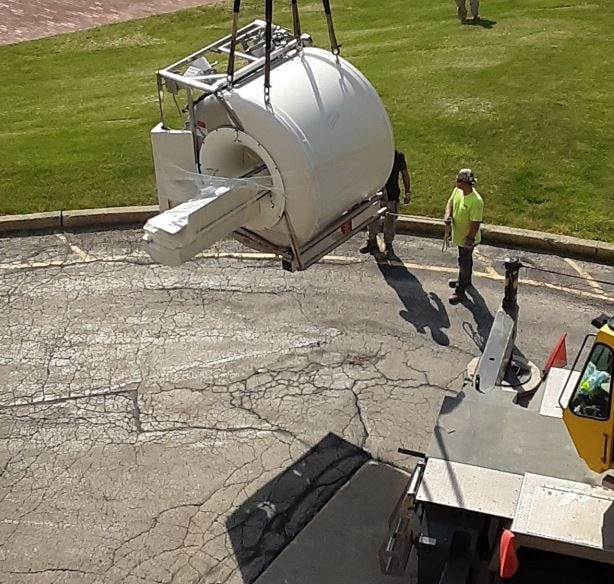 Crews work to take out older MRI machine from ProMedica's Memorial Hospital in Fremont.