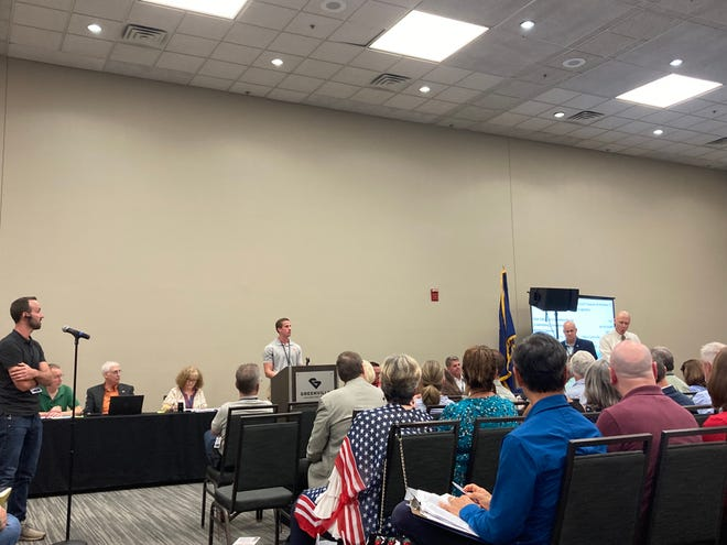 A split room debates whether rules should be suspended or not during a July 12 Greenville County Republican Party meeting at the Greenville Convention Center