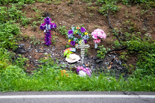 A memorial on Buffat Mill Road in Knoxville on Tuesday, July 13, 2021, marks the scene where a single-car crash led to injuries that claimed the life of 15-month-old Haizley Roper.
