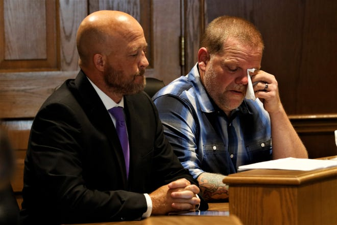 Aaron Conrad sits with his client, Eric Carpenter, during Carpenter's sentencing hearing Tuesday, July 13. He pleaded guilty to one count of reckless homicide, after a gun he owned fired and killed Lidia Ghide in December 2020