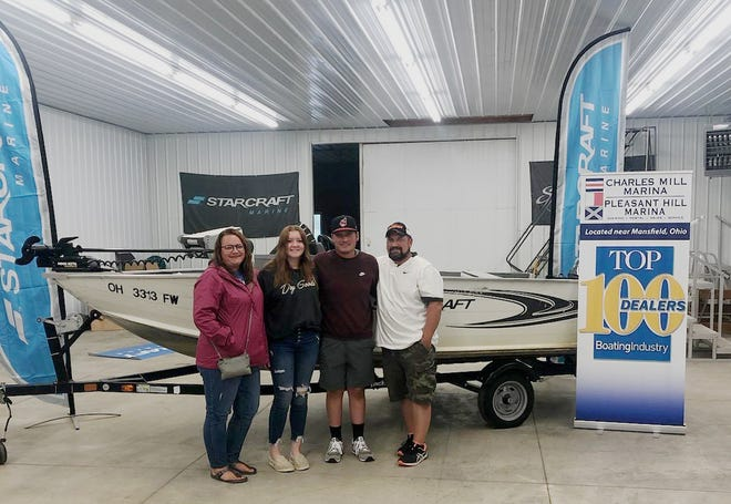 Aaron Issler, second from right, picked up his new boat Sunday from Charles Mill Marina. With him, from left, are his mother, Danyelle Issler, girlfriend, Haleigh Blevins, and father, Jim Issler.