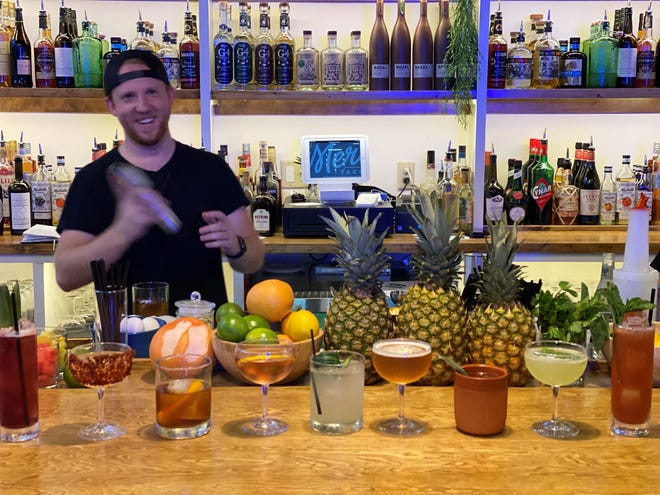 Josh Cox prepares one of each of El Mero Taco's new cocktails at a tasting event for the restaurant's new mezcaleria on July 7, 2021.