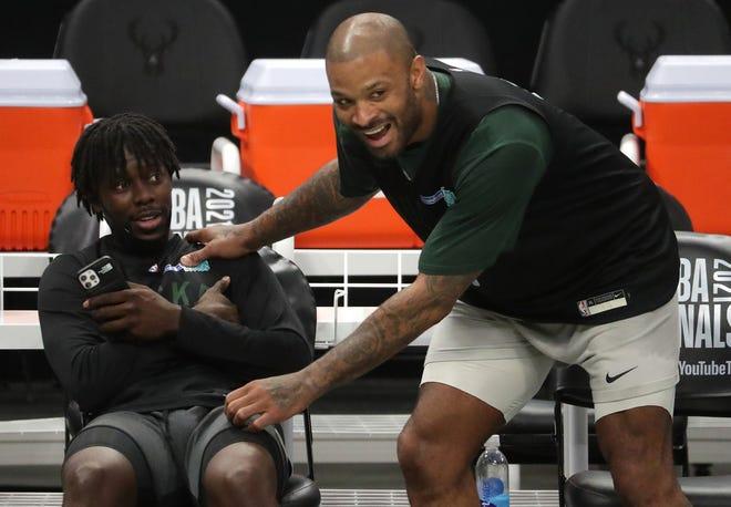Bucks forward P.J. Tucker, rights, jokes with Milwaukee Bucks guard Jrue Holiday during practice Tuesday, July 13, 2021 at Fiserv Forum.