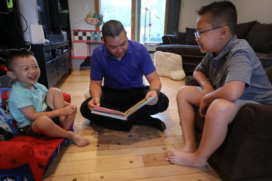 Dr. Minh-Tu Do reads a book to his sons Joey 4 and Justin 9 at home. Both children received the COVID vaccine as part of a Pfizer-BioNTech clinical trial with Rutgers University.