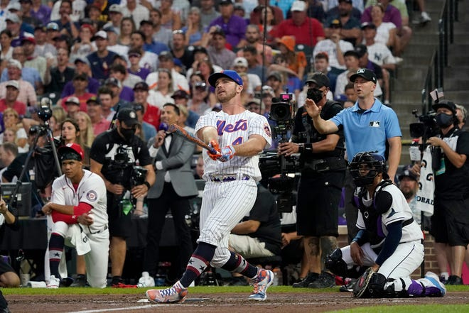 National League's Pete Alonso, of the New York Mets, hits during the second round of the MLB All Star baseball Home Run Derby, Monday, July 12, 2021, in Denver. (AP Photo/Gabriel Christus)