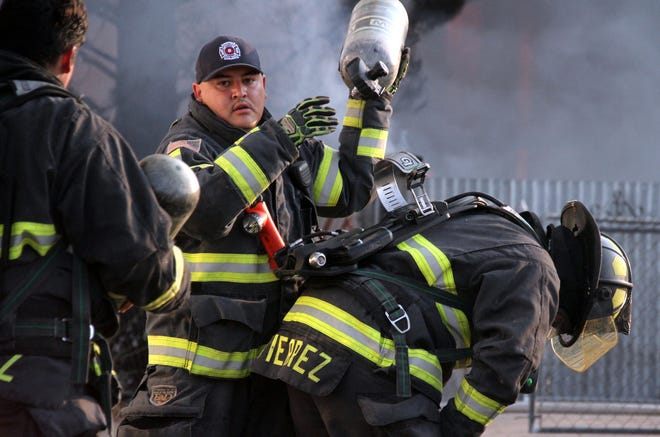 Oxygen tanks helped Deming Firefighters battle the intense flames and smoke during Wednesday morning's structural fire at the 400 block of S. Ruby Street.