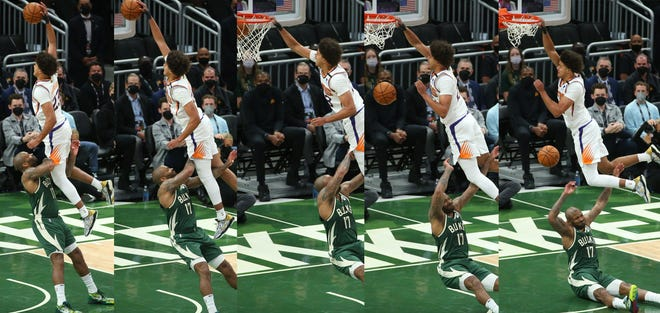 A sequence of Phoenix Suns forward Cameron Johnson (23) slamming two over Milwaukee Bucks forward P.J. Tucker (17) during Game 3 of the NBA Finals at Fiserv Forum July 11, 2021.