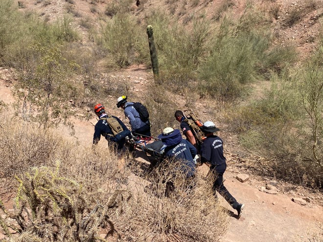 The Phoenix Fire Department's Technical Rescue Team transport a man off Camelback Mountain on May 31, 2021.