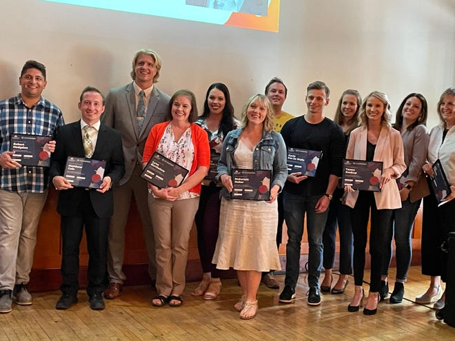 Members (L-R) Robby Hodgdon, Matthew Cole, Logan Wolfe, Lynn Bartholow, Sydney Bartunek Bender, Makenzie Huber, Emmett Reistroffer, Gavin Van De Walle, Rhiannon Israel, Tanna Soukup Carrie Kuhl and Liz Larkin of the second cohort of CO.STARTERS by Startup Sioux Falls pose before their competition pitching their businesses to local leaders at Icon Lounge and Events downtown. July 13th, 2021.