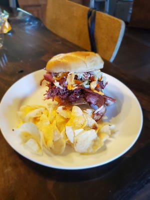 The Big Rygg signature sandwich, created by Jason Meyer of Big Stack Meats & Catering in honor of the show hosts, the Rygg family, is a combination of hamburger, pulled pork, chicken, bacon, cheese and more topped with Silver Spring horseradish sauce.