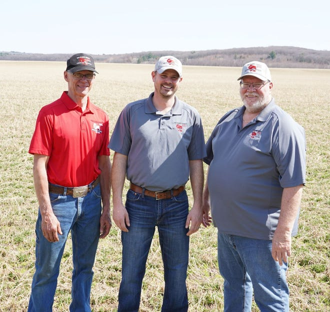 Ken Traaseth, Huntsinger Farms Farm Manager, left, Mike Gintner, Wisconsin Farm Technology Days Eau Claire, Executive Committee Chair, and Mark Hagedorn, Vice Chair, right, were on hand at the show site as the first trailer for Farm Tech Days 2021 was placed on the grounds.