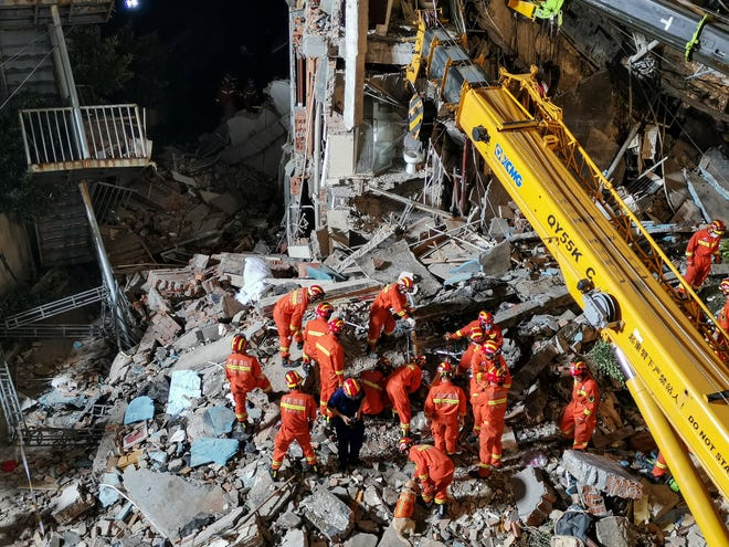 Rescuers search for survivors after a hotel collapsed in Suzhou in China's eastern Jiangsu province on July 12, 2021.