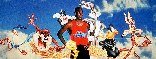 """Michael Jordan surrounded by Warner Bros.  Looney Tunes characters for promotion """"Space Jam."""""""