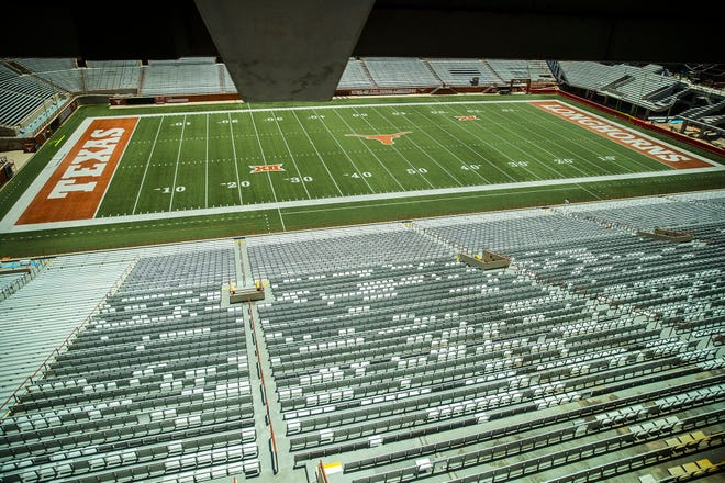 Texas officials paid almost $430,000 for FieldTurf USA to take out the old artificial surface inside Royal-Memorial Stadium, seen here, and install a new surface with end zones that better resemble the burnt orange color.