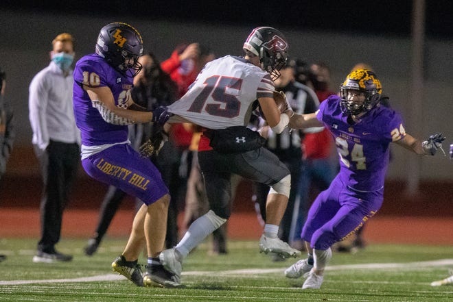 Liberty Hill linebacker Andon Thomas, left, drags down Sharyland Pioneers' Tristan Castillo in a playoff game last season. Thomas returns as a defensive anchor after two all-Centex seasons.
