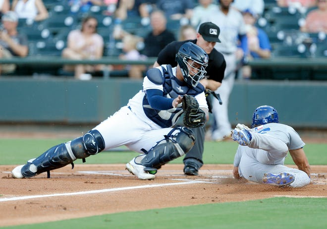 Round Rock Express catcher Yohel Pozo tags Sugar Land Skeeters center fielder Jake Meyers for an out at Dell Diamond earlier in July. Pozo has excelled while his teammates have struggled this month.