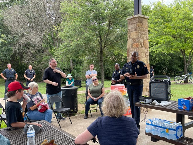 Round Rock Police Chief Allen Banks speaks with residents on July 10 at Chisholm Valley Park, addressing their concerns over a recent rise in crime in the area.