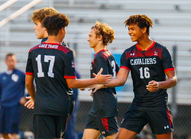 Lake Travis soccer players Tre Wright, right, gets an handshake from teammate Emilio Millan after a goal in a playoff win over Smithson Valley. The boys soccer team had the longest playoff run of any team sport for Lake Travis, which won the Breazeale Cup for the first time in school history.