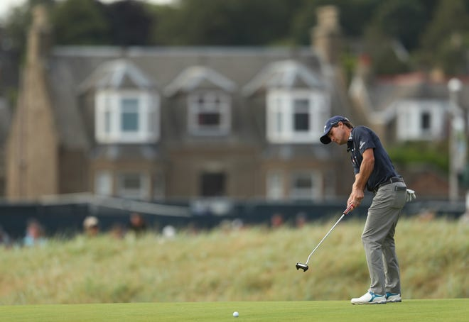 Kevin Kisner of the US putts on the 16th green during the third round of the British Open Golf Championship in Carnoustie, Scotland, Saturday July 21, 2018. (AP Photo/Jon Super)