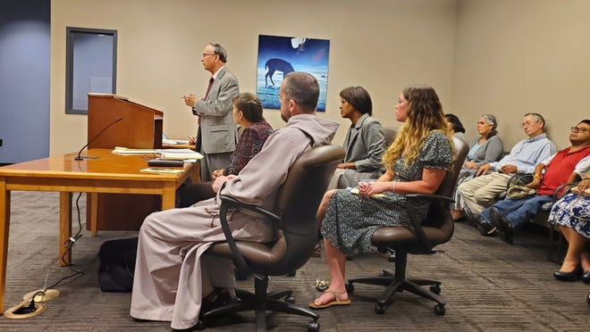 Attorney Don Hicks addresses the court July 9 in support of four anti-abortion activists, seated in the foreground, who are accused of trespassing at the Northeast Ohio Women's Center on June 4.