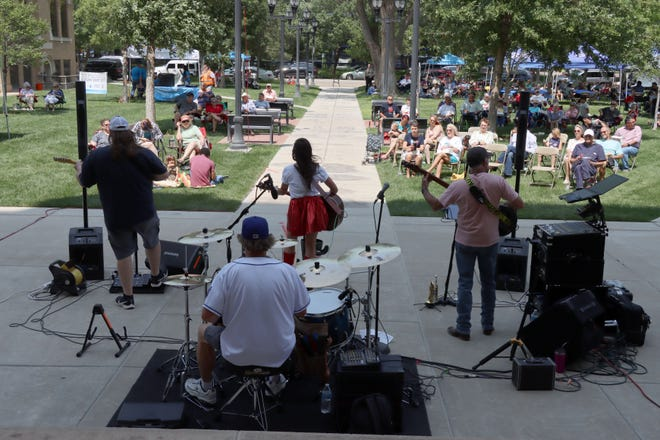Lindsey Lane and her band entertain the audience of High Noon on the Square on the lawn of the Potter County Courthouse Wednesday afternoon.