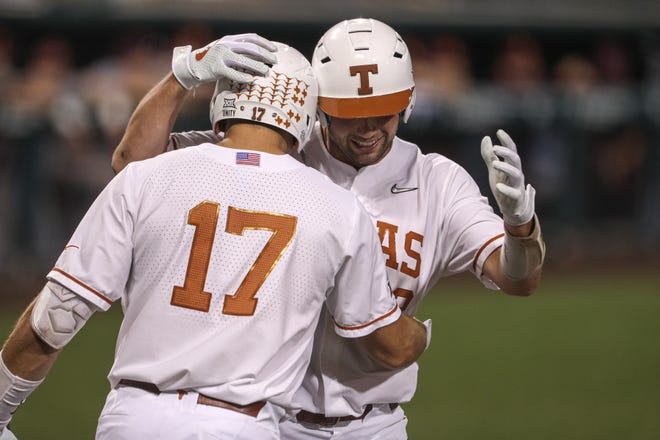 Texas players Zach Zubia, right, and Ivan Melendez celebrate a win over Arizona State at UFCU Disch-Falk Field on June 5. Melendez and Zubia were both selected by the Miami Marlins in this week's MLB amateur draft. In all, seven Longhorns were drafted.