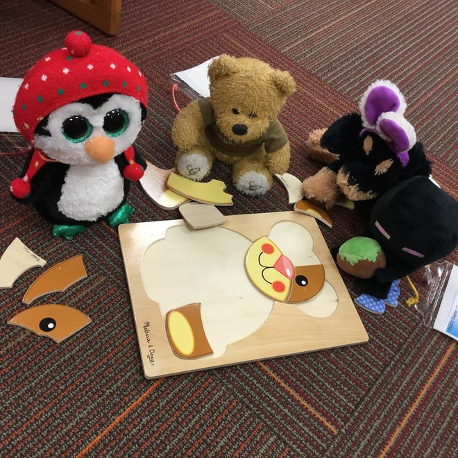 During the 2020 Rodman Public Library stuffed animal sleepover, the overnight guests worked together to complete a puzzle.