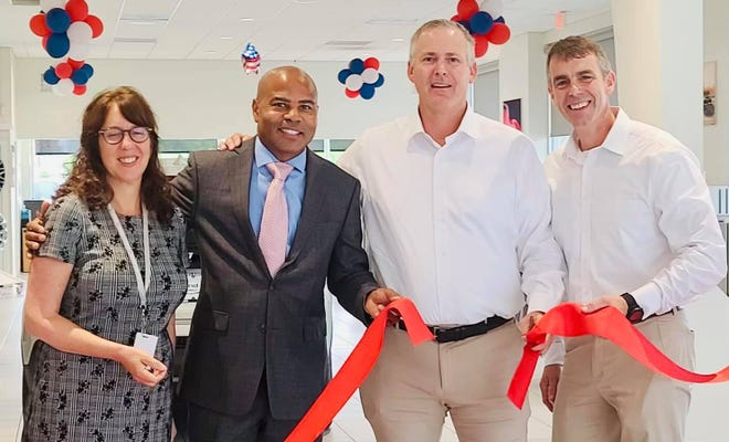 BHS Principal Elizabeth Freedman and Rep. Kip Diggs join Todd Copland and Brian Scarpellini for the grand opening of Copeland Automotive Group (Chevrolet Subaru) in Hyannis Monday. Together, they have created a paid internship for BHS students.