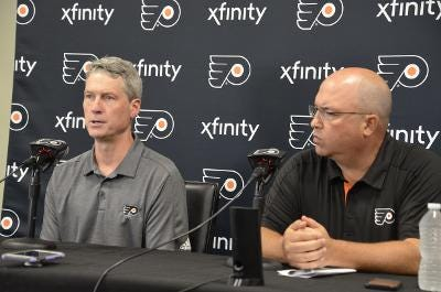 Flyers general manager Chuck Fletcher, left, and assistant general manager Brent Flahr at Tuesday's press briefing.