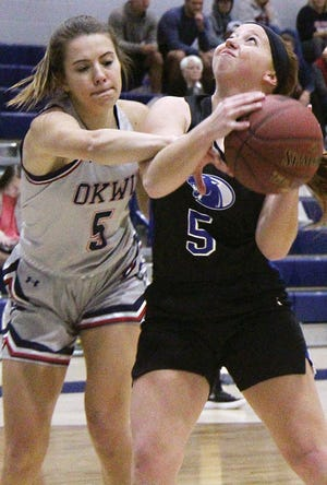 Oklahoma Wesleyan University defender Cierra Johnson, left, blankets an opposing player during women's basketball action within the past two seasons.