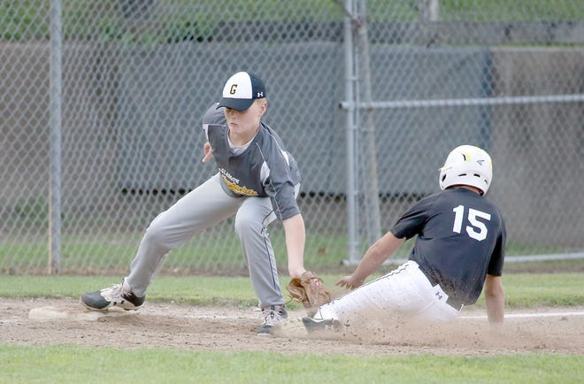 Glasgow third baseman Jackson Meyer applies the tag on Fayette's Austin Kunze in Junior Babe Ruth action Tuesday night at Twillman field in Harley park. Glasgow improved to 1-4 on the season by beating Fayette 17-5 in five innings. Fayette fell to 1-9 on the season.