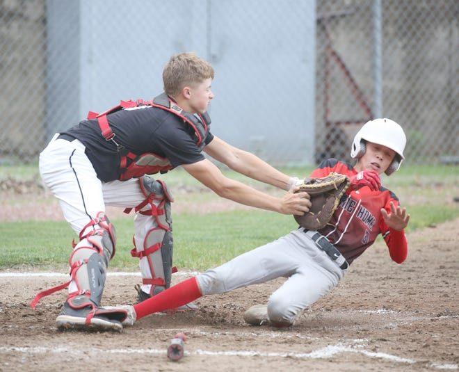 Fayette catcher Jayden Shiflett applies the tag on Prairie Home's Blane Bourgman for the out in the third inning Monday night in Junior Babe Ruth action at Twillman field in Harley park. Fayette picked up its first win of the season in JBR by beating Prairie Home 7-6.