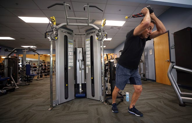 Al Malone works out at the Worthington Community Center on July 9. The fitness floor at the center will be named in honor of former mayor and vice mayor Jim Lorimer.