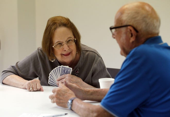 Virginia Rogers shares a laugh with Paul Burkitt as they play bridge at the Hilliard Community Center on July 13. Hilliard voters willbe asked on the Nov. 2 ballot to approve a 0.5-percentage-point income-tax increase that would exclusively support recreation and parks operating expenses, including the construction of a new community center.