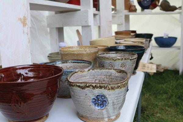 Pottery on display in Centennial Park during a past Waukee Arts Festival. The 2021 event returns on July 16-17.