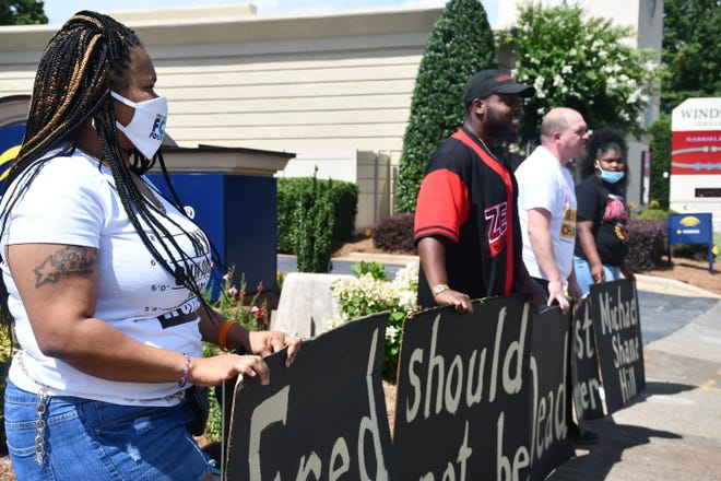 On Tuesday in Winston-Salem, demonstrators Ricquanda Pollard, Cedarian X, Jason Hicks and Mese Love protested the officer-involved fatal shooting of Fred Cox.