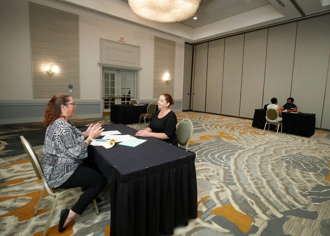 """Potential job candidates participate in interviews for open positions at a recent job fair at the Hilton Daytona Beach Oceanfront Resort. """"I think the Hilton is a classy, sophisticated hotel, with a great feel to it,"""" said Jennifer Pickett, of Palm Coast, among the day's job applicants.  """"There should be hundreds of people here,"""" she said. """"I don't know why there aren't."""""""