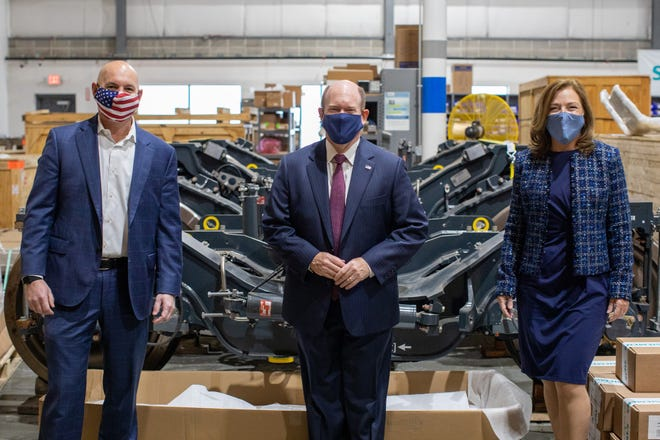 Sen. Chris Coons, D-Delaware, joins Marc Buncher, president of Siemens Mobility Division in the U.S. and Canada, left, and Barbara Humpton, president and CEO of Siemens USA, right, at the Siemens Locomotive Service facility in New Castle on Jan. 25.